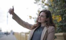 young-woman-in-coat-taking-selfie-with-smartphone-on-street-3776445