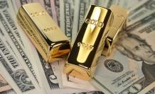 gold-bars-on-us-dollar-bills
