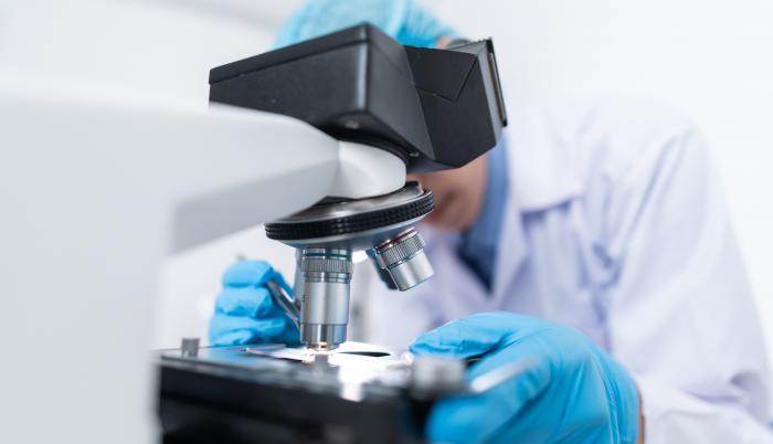 scientist-using-microscope-3938022