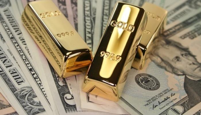 gold-bars-on-us-dollar-bills